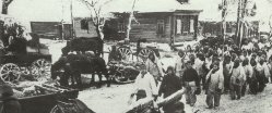 Soldiers of the Red Army move through a retaken village.