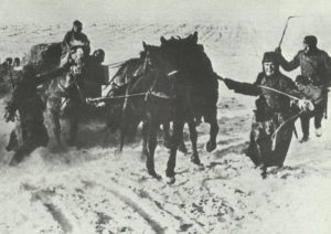 supplies with horses through the deep snow in Russia