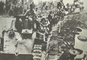 Japanese light tanks cross a provisional bridge