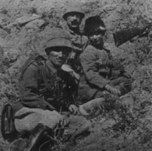 Turkish staff officer with a ten-year-old boy soldier