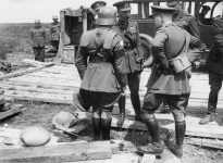 ritish staff officer demonstrates a German helmet and trench armour