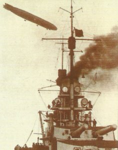 Zeppelin above a 'Kaiser' class battleship