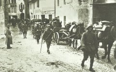 German troops move through a village in northern Italy