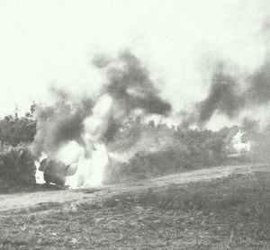 Italian armoured cars blazing on the road to Cap Bone.