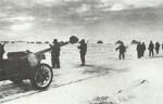 German column of anti-tank guns, infantry and tanks