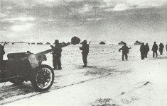 German column of anti-tank guns, infantry and tanks