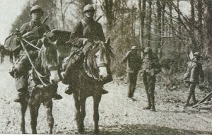French cavalrymen pass British soldiers