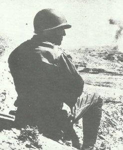 Patton watching a battle