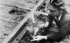 Partisan prepares the blow up of a railroad