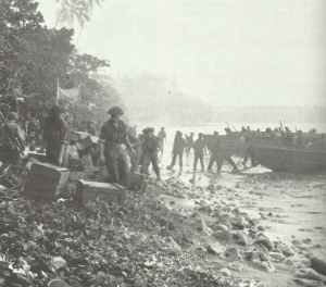 New Zealand troops of the second wave of landings unload provisions from LPCs on Treasury Island