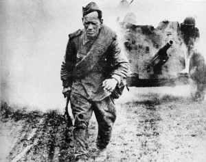 Advancing Russian troops moving a anti-tank gun forward by hand