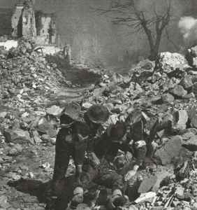 wounded soldier in the ruins of Cassino