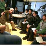 at left pointing: Richard Dreyfuss talks to a group of School of the Arts Seniors (From lower right) Ari Cowan, Nick Rives, Maya Lorton, Jonathan Wong and Aaron Carmack on the John Lennon Education Tour Bus at Macworld Conference & Expo which opens on Monday January 14, 2008 in San Francisco, CA. On Tuesday the Expo opens. Lea Suzuki/ The Chronicle
