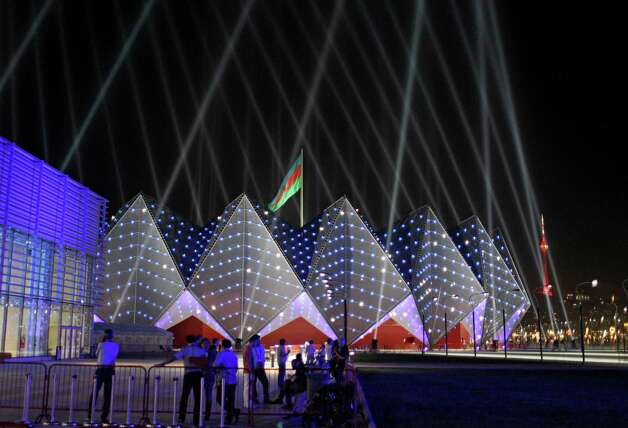 The Baku Crystal Palace is lit by lights during the rehearsals for the 2012 Eurovision Song contest in Baku, Tuesday. The capital of this former Soviet republic has shed its dour, industrial image and evolved into a vibrant metropolis combining the old world charms of Istanbul with the architectural ostentations of Dubai. Now it has the perfect stage to show off its decade-long transformation: the Eurovision Song contest. (AP Photo/Sergey Ponomarev) Photo: Sergey Ponomarev, Associated Press / AP