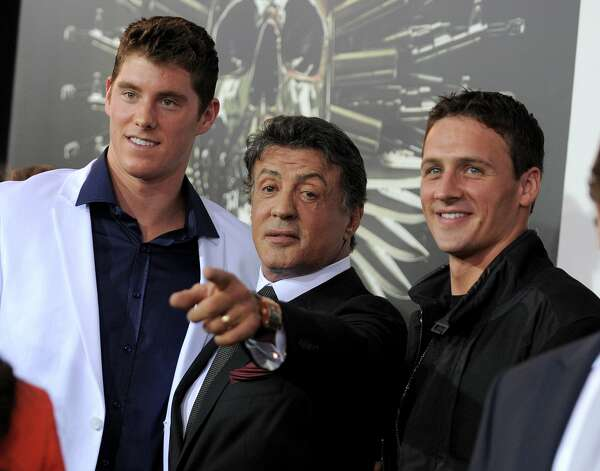 "(L-R) Conor Dwyer, Sylvester Stallone and Ryan Lochte attend the premiere for ""The Expendables 2"" at Grauman's Chinese Theatre on Wednesday, Aug. 15, 2012 in Los Angeles.  (Jordan Strauss / Associated Press) / SF"