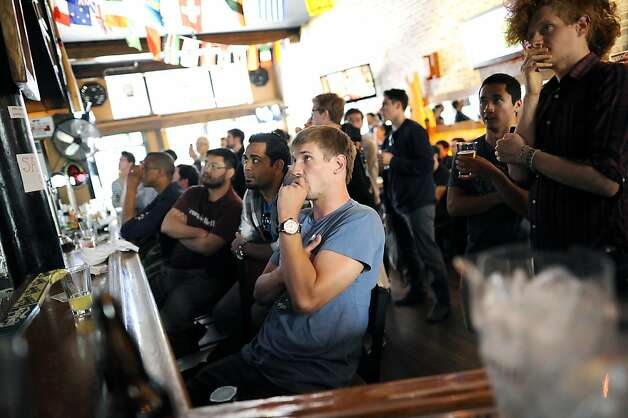 "Just like any broadcast sporting event, the mostly male crowd had their eyes glued to the TVs behind the bar.  ""Barcraft"", a Starcraft video game competition viewing,  was held at Mad Dog in the Fog Pub in San Francisco, CA Sunday August 26th, 2012. Photo: Michael Short, Special To The Chronicle / SF"