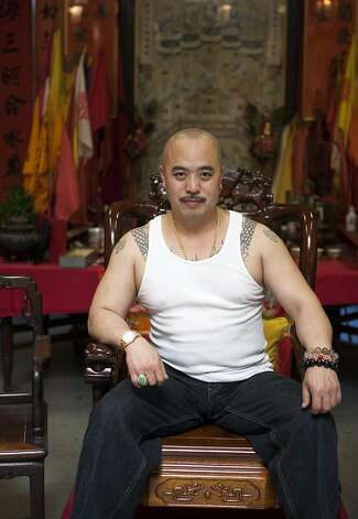 """In this image provided by Jen Siska, Raymond """"Shrimp Boy"""" Chow, is seen posing for a portrait in San Francisco in July 2007.  Investigators say Chow is the leader of one of the most powerful Asian gangs in North America. Chow's gang is said to have lured state Sen. Leland Yee into its clutches through money and campaign contributions in exchange for legislative help, as Yee sought to build his campaign coffers to run for California secretary of state. Yee and Chow were both arraigned on federal gun and corruption charges on Wednesday, March 26, 2014. (AP Photo/Jen Siska) MAGS OUT NO SALES NO ARCHIVE Photo: Jen Siska, Associated Press"""