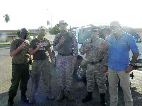 Photos showing dozens of members of the militia groups on the U.S.-Mexico border carrying semi-automatic rifles and wearing masks, camouflage and tactical gear provide one of the first glimpses into the group's activities on the border. Photo: Provided To The San Antonio Express-News
