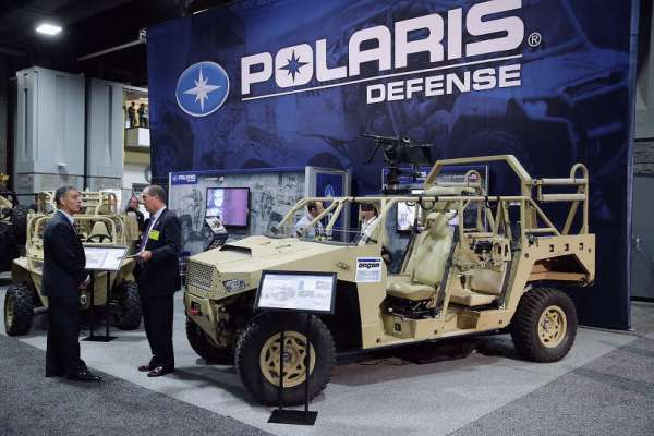 The Polaris Industries Defense exhibit booth displays ...