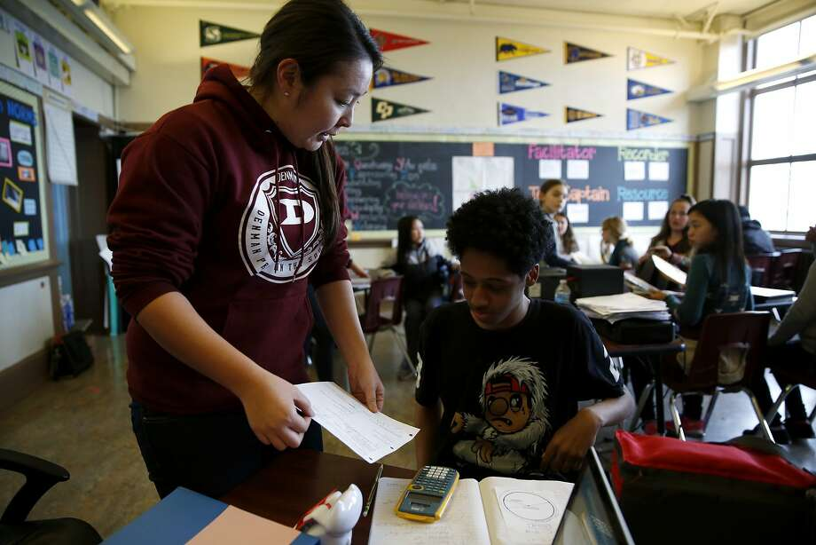 Teacher Yuka Walton helps a student with his math homework in advisory class at James Denman Middle School in San Francisco, California, on Tuesday, Feb. 2, 2016. Photo: Connor Radnovich, The Chronicle