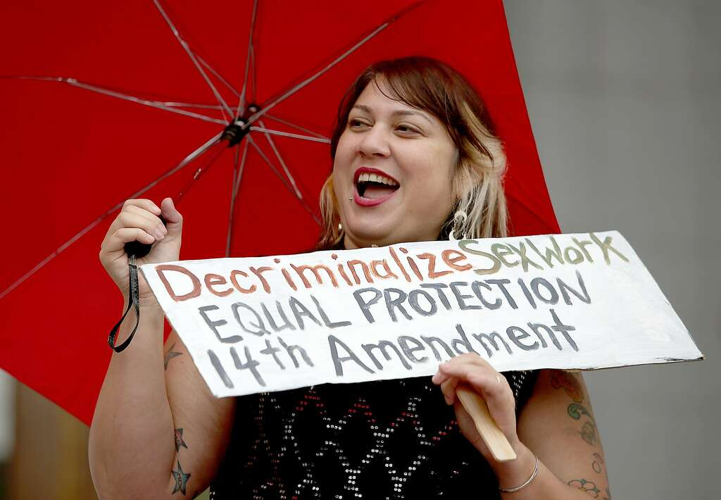 Sophia Amelia (left) protests the raid on Backpage outside of the California Supreme Court on Tuesday, October 26, 2016, in San Francisco, Calif. Photo: Liz Hafalia, The Chronicle