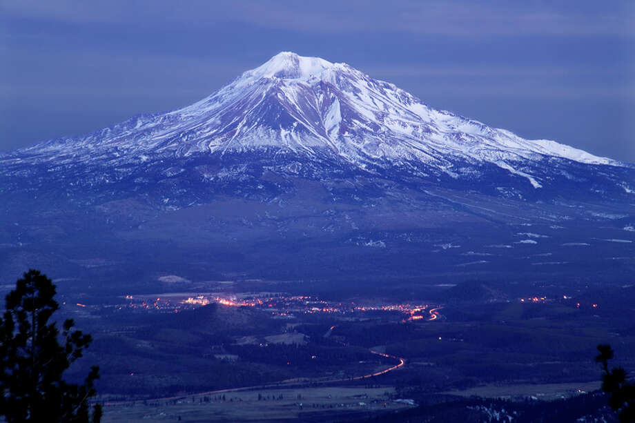 Mount Shasta looming over the town of Weed in the evening. Photo: USGS