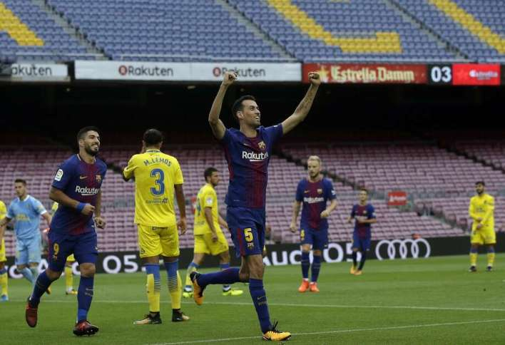 Barcelona's Sergio Busquets celebrates his goal before empty seats at Camp Nou. The game was played without fans amid the controversial referendum on Catalonia's independence. Photo: Manu Fernandez, Associated Press