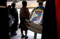 A Tibetan flag adorns a drum that will be played in the performance.