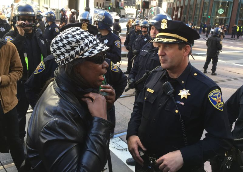 Felicia Jones with the Justice 4 Mario Woods Coalition talks to SFPD Commander Robert O'Sullivan at a police line blocking the march from the gates of 'Super Bowl City' on Jan. 30.
