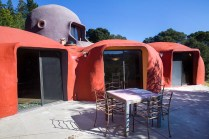 The patio of the Flintstone House stretches all along the back of the house.