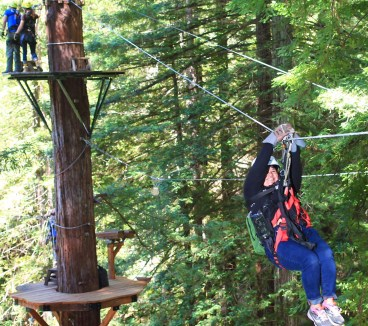 Producer Suzie Racho ziplines high above the redwoods in Sonoma County.