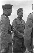 387px-Bundesarchiv_B_145_Bild-F016198-34,_Rumänien,_Brückenbau_am_Pruth,_Offiziere