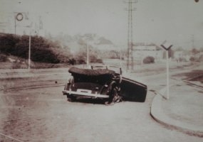 Staff car damaged by the bomb thrown into the back seat.