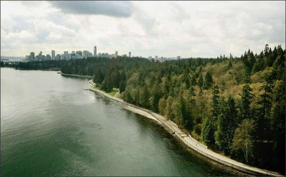 Stanley Park viewed from Lions Gate Bridge, with downtown Vancouver in the distance. Photo: DAN DELONG/P-I