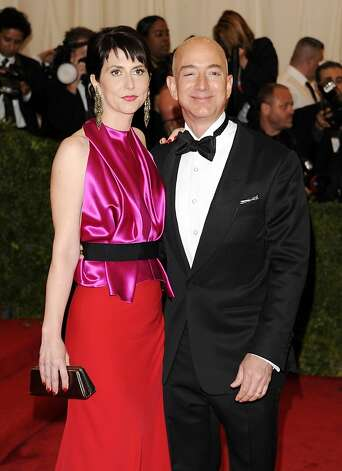 In a Monday, May 7, 2012 file photo, Amazon founder, president and CEO Jeff Bezos and wife Mackenzie Bezos arrive at the Metropolitan Museum of Art Costume Institute gala benefit, celebrating Elsa Schiaparelli and Miuccia Prada, in New York. Bezos and his wife MacKenzie announced a gift Friday, July 27, 2012 of $2.5 million to the campaign to defend Washington's same-sex marriage law.   (AP Photo/Evan Agostini, File) Photo: Evan Agostini, Associated Press / SF