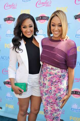 Actresses Tamera Mowry (L) and Tia Mowry attend the 2013 Teen Choice Awards at Gibson Amphitheatre on August 11, 2013 in Universal City, California.  (Photo by Kevin Mazur/WireImage) Photo: Kevin Mazur, WireImage