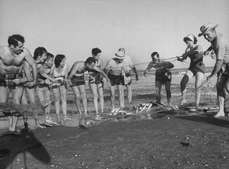 Surf fishing with net, 1961.