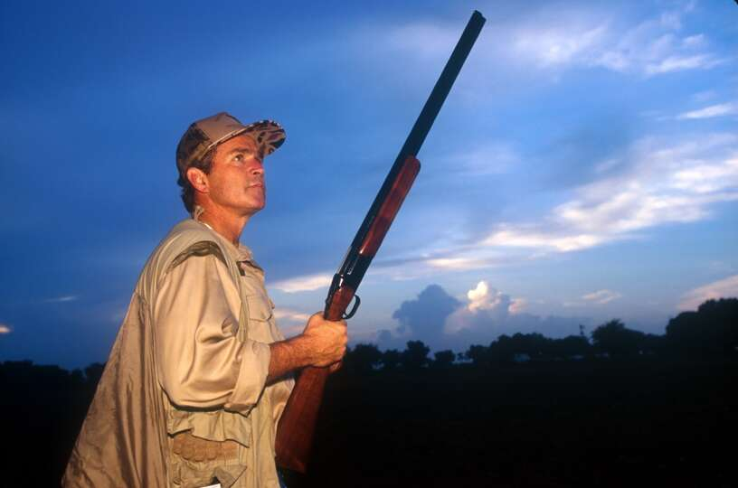 Texas Governor George W. Bush looks up at the sky for an opportunity on the first day of Dove huntin