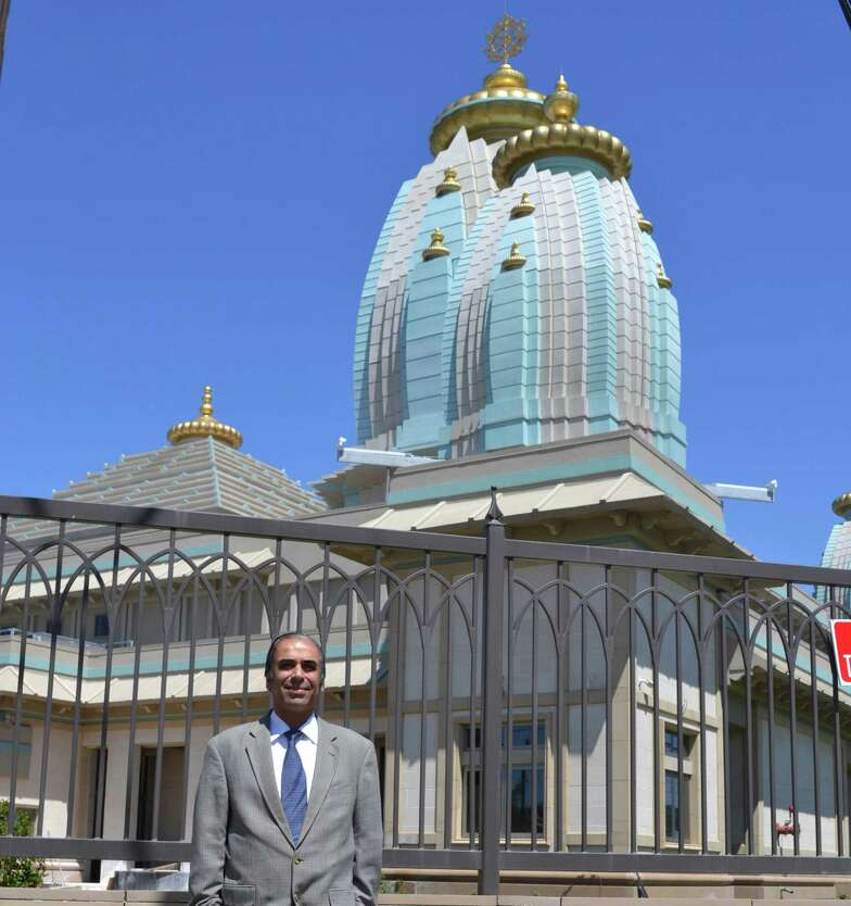 Dr. Sanjay Khanduja, nephew of Dr. R.K. Dhingra and the adminis- trator of the estate, recently visted the site of a New Temple built with a $20 million donation from his uncle's estate.