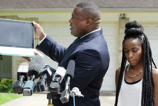 Quanell X talks to the media Thursday, July 10, 2014, in Houston outside a home at 12506 Chessington Dr. where a 16-year-old girl identifying herself as Jada said she was drugged and raped during a house party. Photo: Melissa Phillip, Houston Chronicle / © 2014  Houston Chronicle