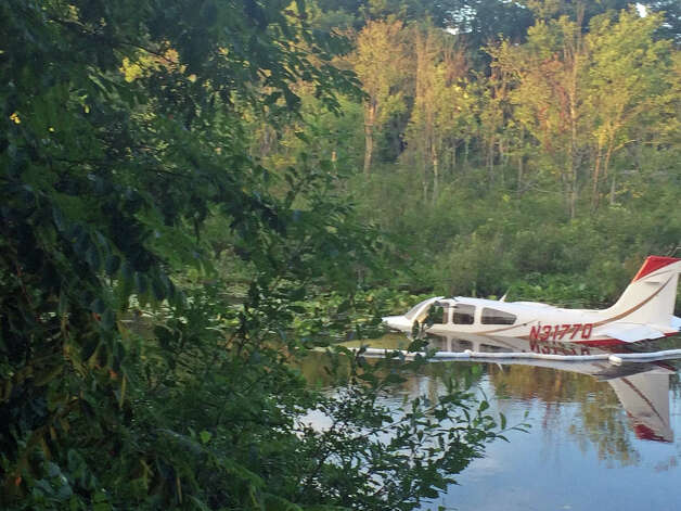 This 1984 single-engine Beechwood Bonanza aircraft made a crash landing Thursday night, July 24, 2014, in a swamp on Miry Brook Road, next to the Danbury Municipal Airport. The unnamed pilot was not injured. The plane is registered to Lionel G. Brown of Newtown. Photo: Contributed Photo / News-Times Contributed