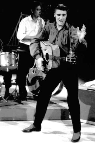 "FILE - In this Sept. 9, 1956 file photo originally released by the Museum of Television & Radio, Elvis Presley performs on the ""Ed Sullivan Show,"" in New York. (AP Photo/Museum of Television & Radio, file) Photo: Anonymous, Associated Press / MUSEUM OF TELEVISION & RADIO"
