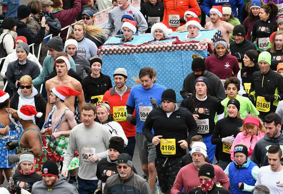 Costumed runners make their way in the 2016 Troy Turkey Trot on Nov. 24, 2016. (Michael P. Farrell/Times Union)