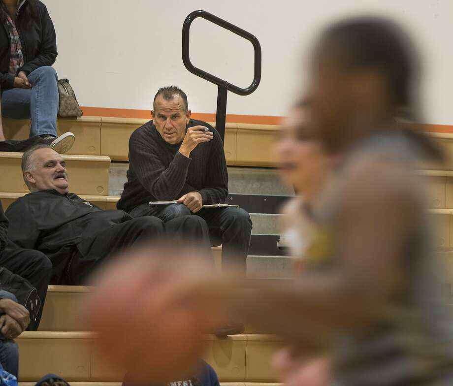 Half Moon Bay Review sportswriter John Murphy, working in place of popular, longtime reporter Mark Foyer, covers the local high school's basketball team's game against Menlo School last week. Photo: Paul Kuroda, Special To The Chronicle