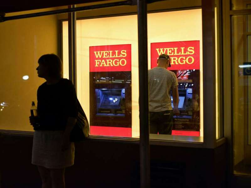 While Wells Fargo branch employees aggressively pressured consumers to sign up for new accounts, commercial bankers adopted a relatively stingy approach to lending money to companies. Photo: Patrick Sison, Associated Press