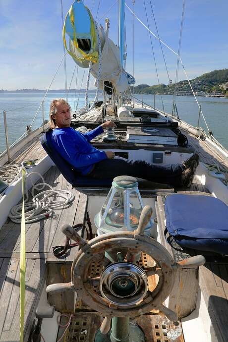 Jean Michel relaxes in his sailboat while it is anchored on Richardson Bay. Photo: Michael Macor, The Chronicle