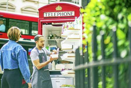 Ben Spier, owner of Spier Salads, fills a customer order at his converted red telephone box in Bloomsbury Square in London. Photo: Miles Willis — Bloomberg Photo / Bloomberg