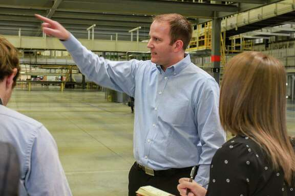 Brady Bates talks to media, inside the new FedEx Ground 800,000-square-foot automated distribution hub in Houston. Bates is senior manager of the Houston hub.   (For the Chronicle/Gary Fountain, October 26, 2017)
