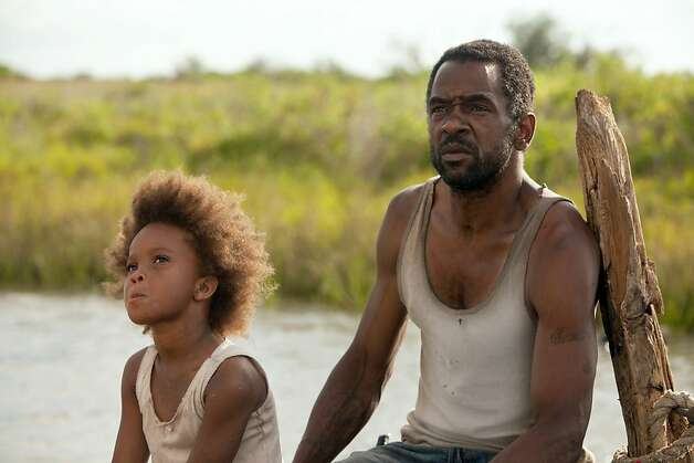 """Quvenzhane Wallis as """"Hushpuppy"""" and Dwight Henry as """"Wink"""" on the set of BEASTS OF THE SOUTHERN WILD. Photo: Mary Cybulski, Fox Searchlight / SF"""