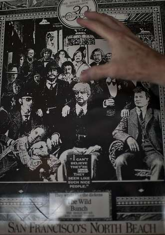 AD Winans shows himself in a smaller version of a 1970's poster of poets gathered at Vesuvio bar, in the North Beach neighborhood of San Francisco, Calif on Friday, July 13, 2012. Photo: Yue Wu, The Chronicle / SF